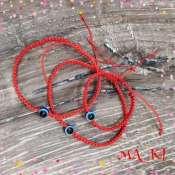 Плетеный браслет с глазом Фатима